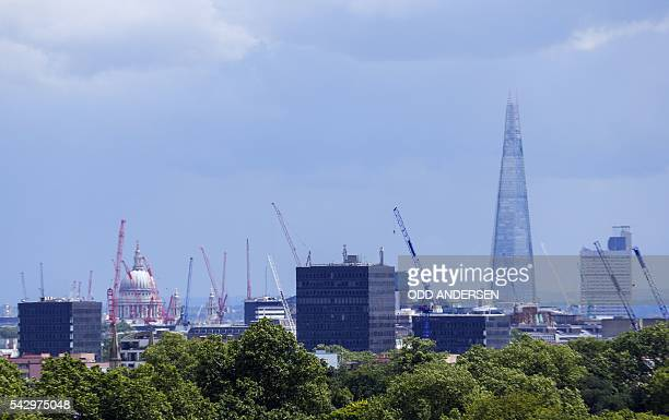 London landmarks including the St Paul's Cathedral and the Shard are pictured with construction cranes on the skyline from Primrose Hill in north...