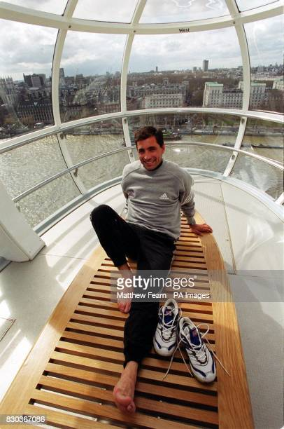 London Marathon winner Antonio Pinto from Portugal looks over the London skyline on the British Airways London Eye the day after winning the race in...