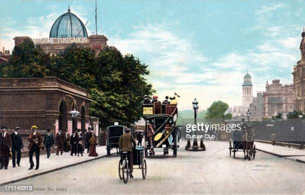 London Marylebone Road / Madame Tussauds in background/ with horse drawn trams and carriages early 1900s Pedestrians Lamp post