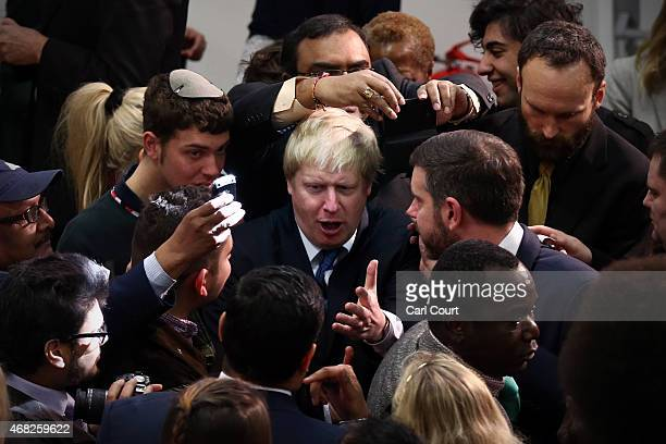 London Mayor and Conservative parliamentary candidate for Uxbridge and South Ruislip Boris Johnson attempts to push through a crowd of admirers as he...