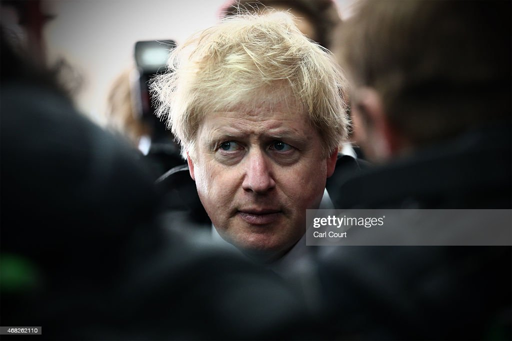 London Mayor and Conservative parliamentary candidate for Uxbridge and South Ruislip Boris Johnson is surrounded by media while visiting a shop as he...