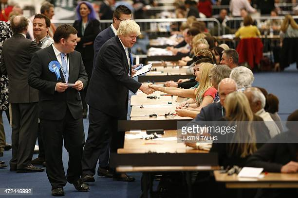 London Mayor and Conservative Party parliamentary candidate for Uxbridge and Ruislip South Boris Johnson shakes hands with counting staff as he...