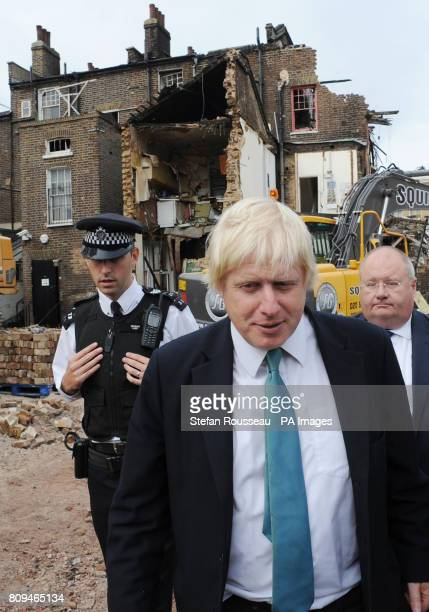 London Mayor Boris Johnson and Communities Secretary Eric Pickles are shown some of the damage to property in Tottenham north London today after...