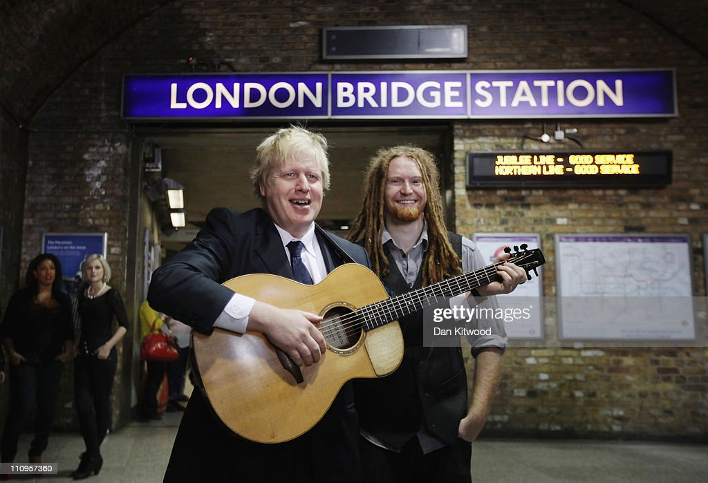 London Mayor <a gi-track='captionPersonalityLinkClicked' href=/galleries/search?phrase=Boris+Johnson&family=editorial&specificpeople=209016 ng-click='$event.stopPropagation()'>Boris Johnson</a> (L) and musician <a gi-track='captionPersonalityLinkClicked' href=/galleries/search?phrase=Newton+Faulkner&family=editorial&specificpeople=803617 ng-click='$event.stopPropagation()'>Newton Faulkner</a> pose during a photocall at London Bridge Underground station on March 28, 2011 in London, England. The Mayor of London was joined by the musician to highlight the capital's Rhythm of London underground busking competition, which takes place between April 16 to 23, 2011.