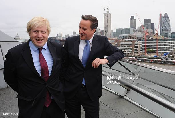London Mayor Boris Johnson and Prime Minister David Cameron are seen following Johnson's reelection as the Mayor of London on May 5 2012 at City Hall...