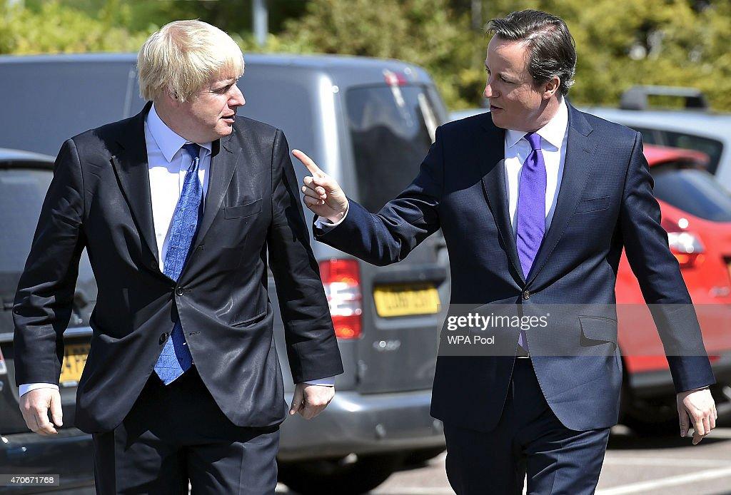 London Mayor Boris Johnson and Prime Minister David Cameron arrive at the Advantage children's daycare nursery on April 22 2015 in Surbiton England...