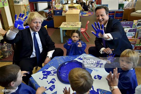 London Mayor Boris Johnson and Prime Minister David Cameron react as they join a handprinting session with children at the Advantage children's...