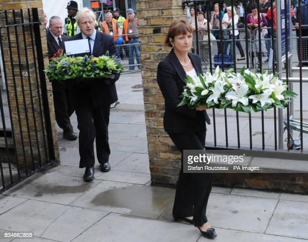 London Mayor Boris Johnson and Tessa Jowell Minister responsible for Humanitarian Assistance lay flowers at Kings Cross Station London to mark the...