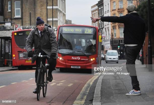 London Mayor Boris Johnson arrives to join Metropoiltan Police Commissioner Bernard HoganHowe and members of the Dalston Safer Neighbourhood scheme...