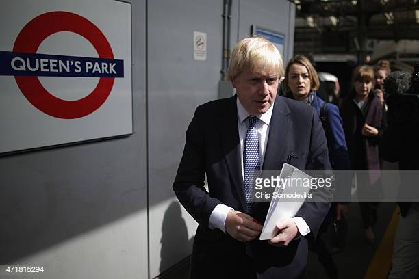 London Mayor Boris Johnson boards a train with the BBC's Newsnight Chief Correspondent Laura Kuenssberg at Queen's Park Overground Station in between...