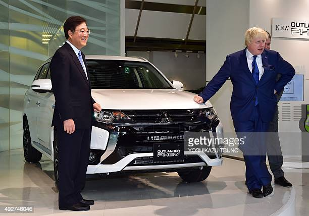 London Mayor Boris Johnson displays the Mitsubishi Motors plugin hybrid vehicle 'Outlander PHEV' at the MMC headquarters in Tokyo on October 15 2015...