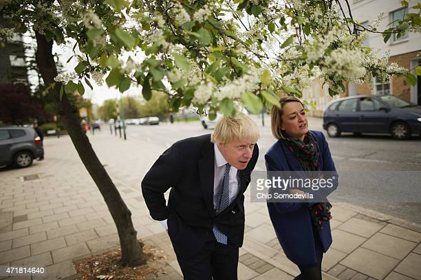 London Mayor Boris Johnson ducks below tree branches while being interviewed by the BBC's Newsnight Chief Correspondent Laura Kuenssberg in between...