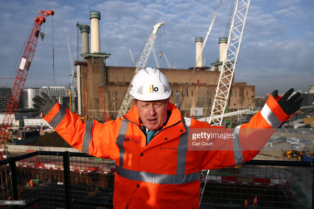 London Mayor Boris Johnson gestures as he poses for a photograph to mark the start of major works to build London Underground's Northern line...