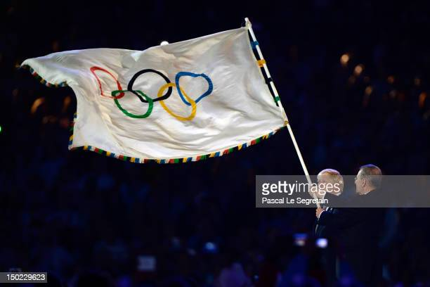 London Mayor Boris Johnson hands over the Olympic flag to Jacques Rogge the President of the International Olympic Committee during the Closing...