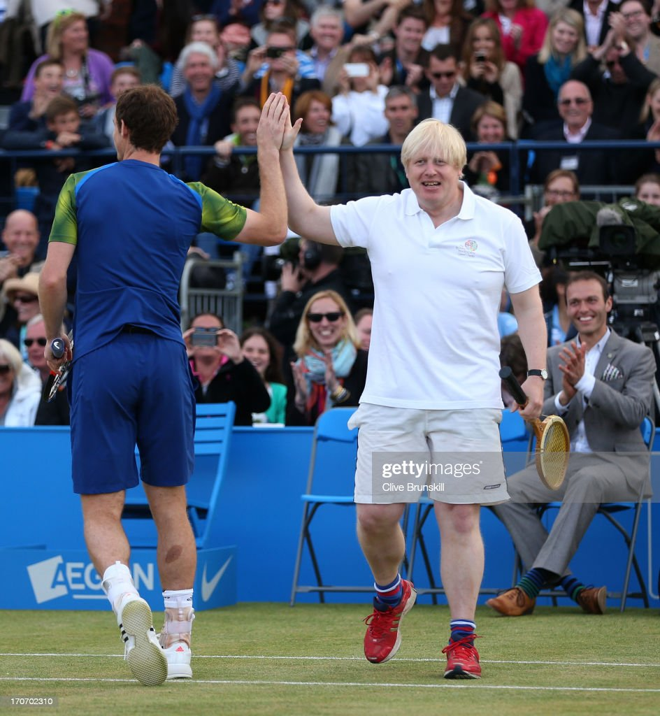 London Mayor <a gi-track='captionPersonalityLinkClicked' href=/galleries/search?phrase=Boris+Johnson&family=editorial&specificpeople=209016 ng-click='$event.stopPropagation()'>Boris Johnson</a> hi-fives <a gi-track='captionPersonalityLinkClicked' href=/galleries/search?phrase=Andy+Murray+-+Tennis+Player&family=editorial&specificpeople=200668 ng-click='$event.stopPropagation()'>Andy Murray</a> during the Rally Against Cancer charity match on day seven of the AEGON Championships at Queens Club on June 16, 2013 in London, England.