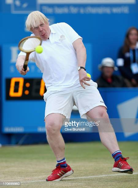 London Mayor Boris Johnson in action during the Rally Against Cancer charity match on day seven of the AEGON Championships at Queens Club on June 16...