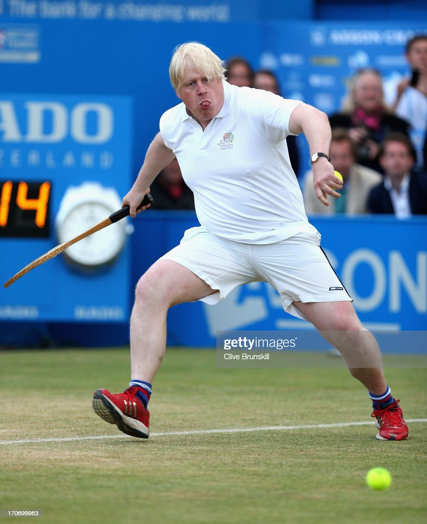 London Mayor <a gi-track='captionPersonalityLinkClicked' href=/galleries/search?phrase=Boris+Johnson&family=editorial&specificpeople=209016 ng-click='$event.stopPropagation()'>Boris Johnson</a> in action during the Rally Against Cancer charity match on day seven of the AEGON Championships at Queens Club on June 16, 2013 in London, England.
