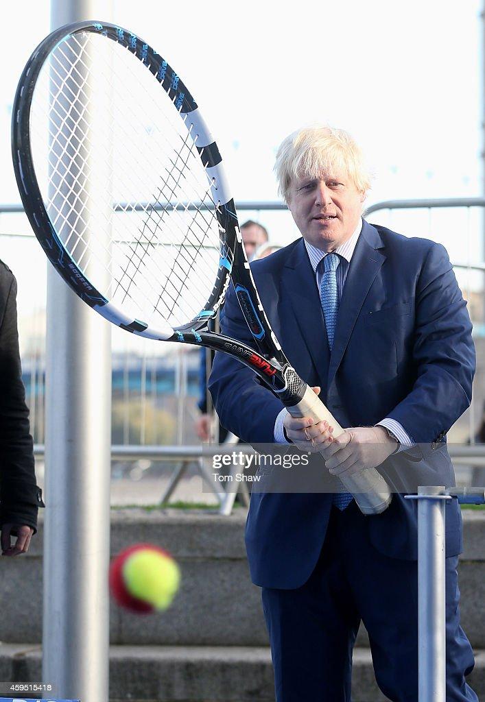 London Mayor Boris Johnson looks on during the wheelchair tennis photocall to promote the NEC Wheelchair Tennis Masters tournament on November 24...