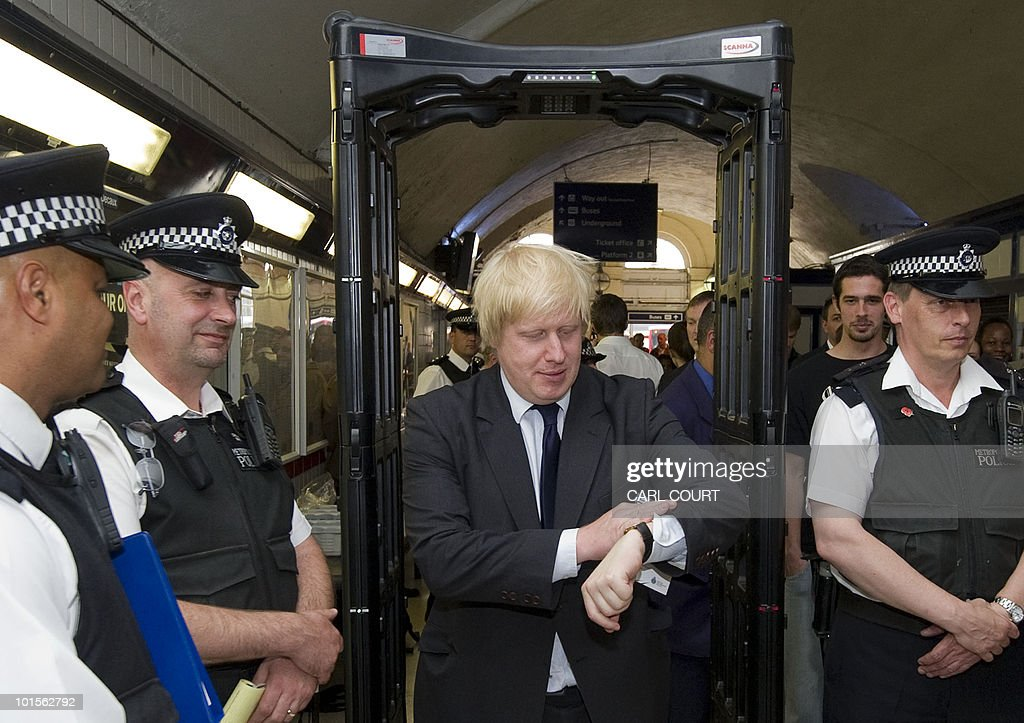 London mayor Boris Johnson (C) passes through a screening arch as he visits an anti-knife crime team in south London, on June 2, 2010. The visit by the mayor was a part of a 'a half term stop and search operation' in a bid to search for weapons. AFP PHOTO/Carl Court