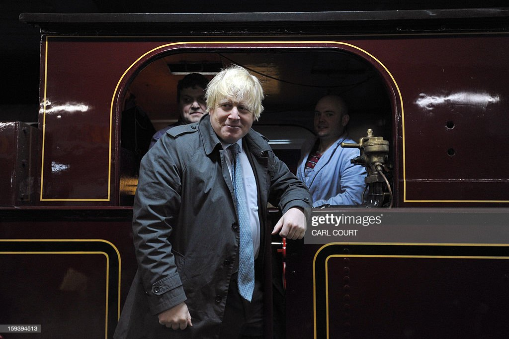 London mayor Boris Johnson poses with train operators for photographers in a steam train hich carried passengers in the 19th century as it arrived at Moorgate Underground Station in central London on January 13, 2013, to mark 150 years since the first London underground journey.