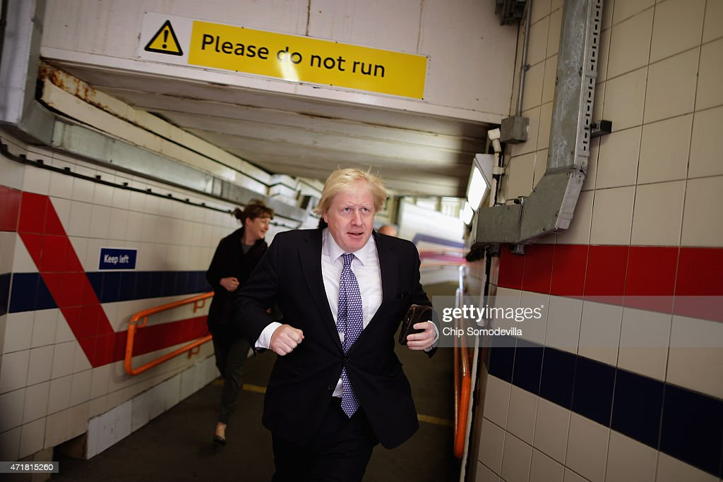 London Mayor Boris Johnson runs between platforms at the Willesden Junction Rail Station in between campaing stops with Conservative candidates on...