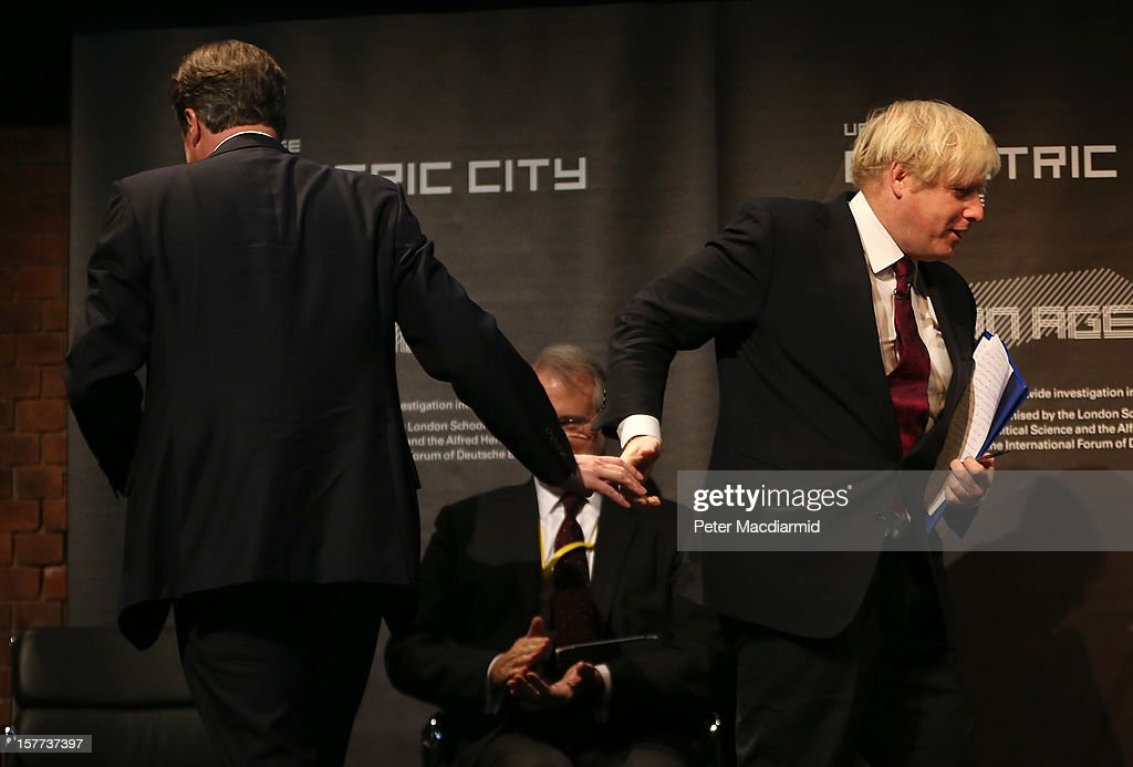 London Mayor Boris Johnson (R) shakes hands with Prime Minister David Cameron at the The Electric City Conference on December 6, 2012 in London, England. The conference is looking at how the combined forces of technological innovation and the global environment crisis are affecting urban society.