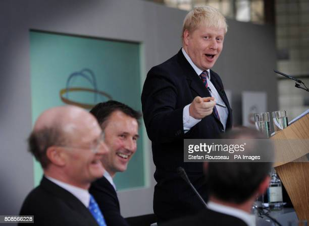 London Mayor Boris Johnson shares a joke with Secretary of State for Culture Olympics Media and Sport Jeremy Hunt and Universities and Science...