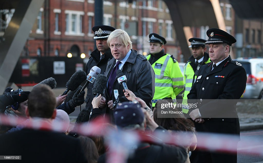London Mayor Boris Johnson speaks to the media after a helicopter reportedly collided with a crane attached to St Georges Wharf Tower in Vauxhall, on January 16, 2013 in London, England. According to reports, the helicopter hit the crane before plunging into the road below during the morning rush hour. Two people died and nine casualties have been confirmed with one in a critical condition.