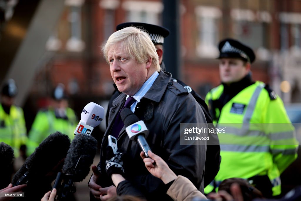 London Mayor <a gi-track='captionPersonalityLinkClicked' href=/galleries/search?phrase=Boris+Johnson&family=editorial&specificpeople=209016 ng-click='$event.stopPropagation()'>Boris Johnson</a> speaks to the media after a helicopter reportedly collided with a crane attached to St Georges Wharf Tower in Vauxhall, on January 16, 2013 in London, England. According to reports, the helicopter hit the crane before plunging into the road below during the morning rush hour. Two people died and nine casualties have been confirmed with one in a critical condition.