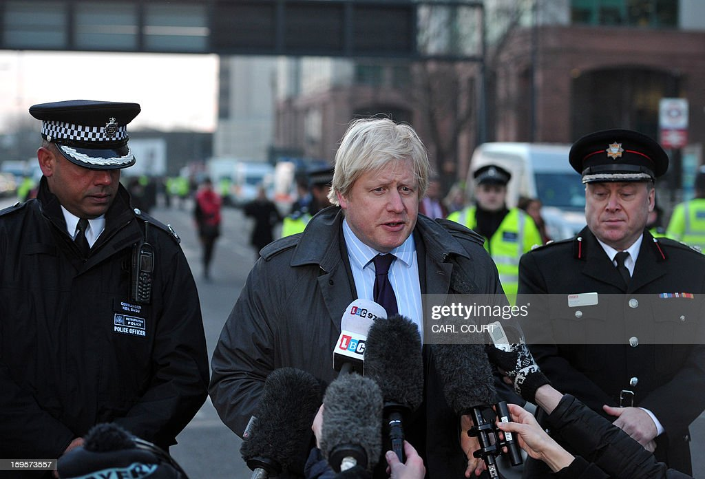 London mayor Boris Johnson speaks to the media in Vauxhall in south London near the site of a helicopter crash earlier this morning on January 16, 2013. Two people were killed when a helicopter hit a crane at a building site in central London during morning rush hour and plunged to the ground in a ball of flames.