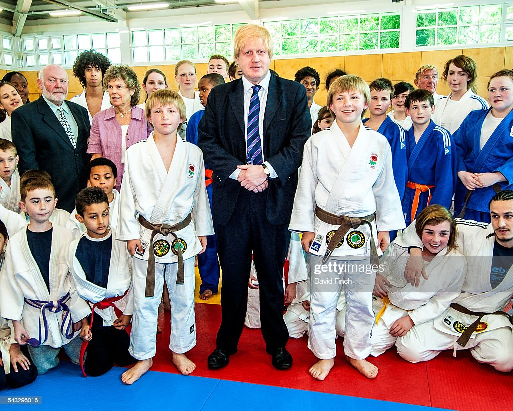 London Mayor, <a gi-track='captionPersonalityLinkClicked' href=/galleries/search?phrase=Boris+Johnson&family=editorial&specificpeople=209016 ng-click='$event.stopPropagation()'>Boris Johnson</a>, stands with two young judoka during his 2009 Mayoral visit to the recently built Croydon Judo Club on the 28 April to announce his £30m London sports programme in Croydon, Greater London, England.