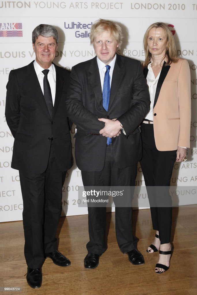 London Mayor Boris Johnson Susan Whiteley and Yves Carcelle attend a photocall to launch the Louis Vuitton Young Arts Project at Royal Academy of...