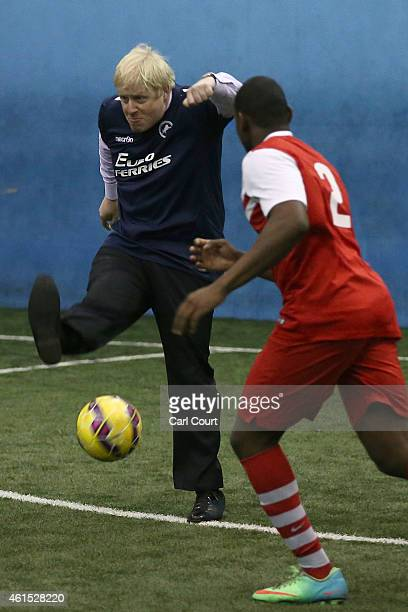 London mayor Boris Johnson takes part in a game of football during a visit to the Millwall Football Club Community Trust on January 14 2015 in London...