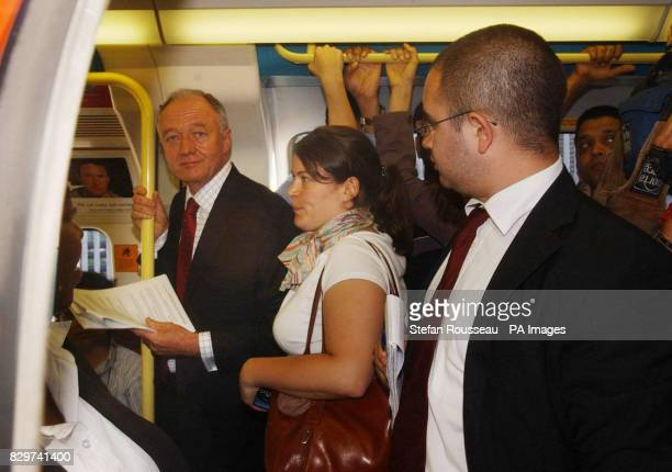 London Mayor Ken Livingstone boards a tube train at Willesden Green underground station to travel to his office at City Hall