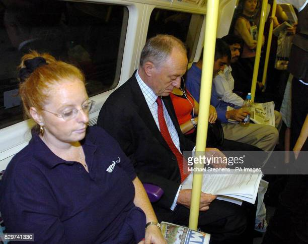 London Mayor Ken Livingstone on a tube train on his way to his office in City Hall London on the Jubilee line from Willesden Green