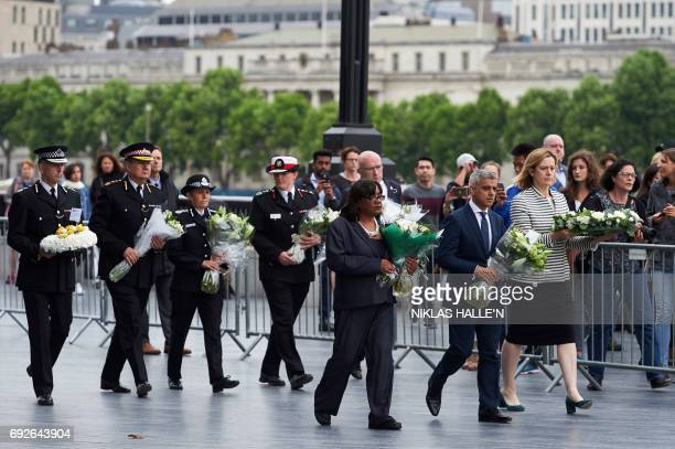 London Mayor Sadiq Khan Home Secretary Amber Rudd and Shadow Home Secretary Diane Abbott hold flowers at Potters Fields Park in London on June 5...