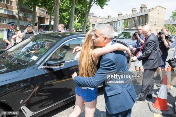 London Mayor Sadiq Khan hugs young Charlene Nolan out St Clements Church on Treadgold Street in Notting Dale after family attended church service...
