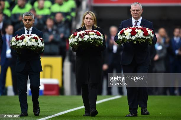 London mayor Sadiq Khan Secretary of State for Culture Media and Sport Karen Bradley and FA chairman Greg Clarke lay wreaths on the pitch for the...