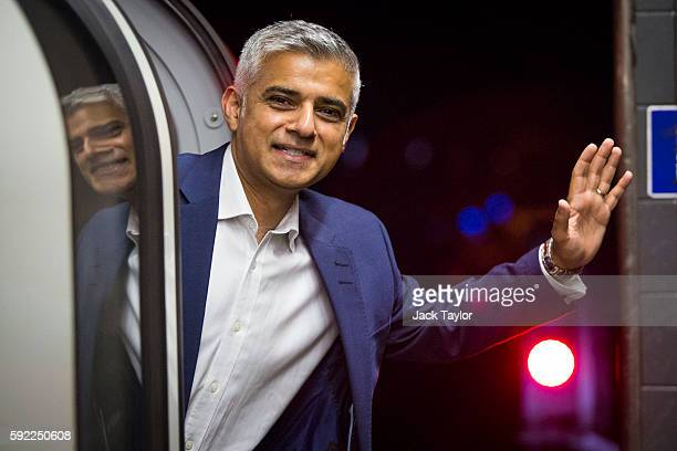 London Mayor Sadiq Khan waves from the first Night Tube train to leave from Brixton Underground Station on August 20 2016 in London England The...