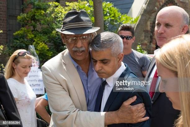 London Mayor Sadiq Khan with local resident outside St Clements Church following Sunday morning service on 18th June 2017 in North Kensington London...