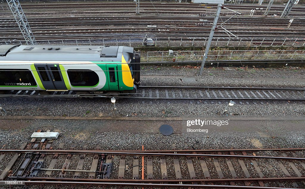 A London Midland train arrives at Euston railway station in London, U.K., on Thursday, Jan. 3 2013. Rail commuters have been hit by inflation busting fare increases of up to 10 per cent, adding hundreds of pounds to the cost of annual season tickets. Photographer: Chris Ratcliffe/Bloomberg via Getty Images