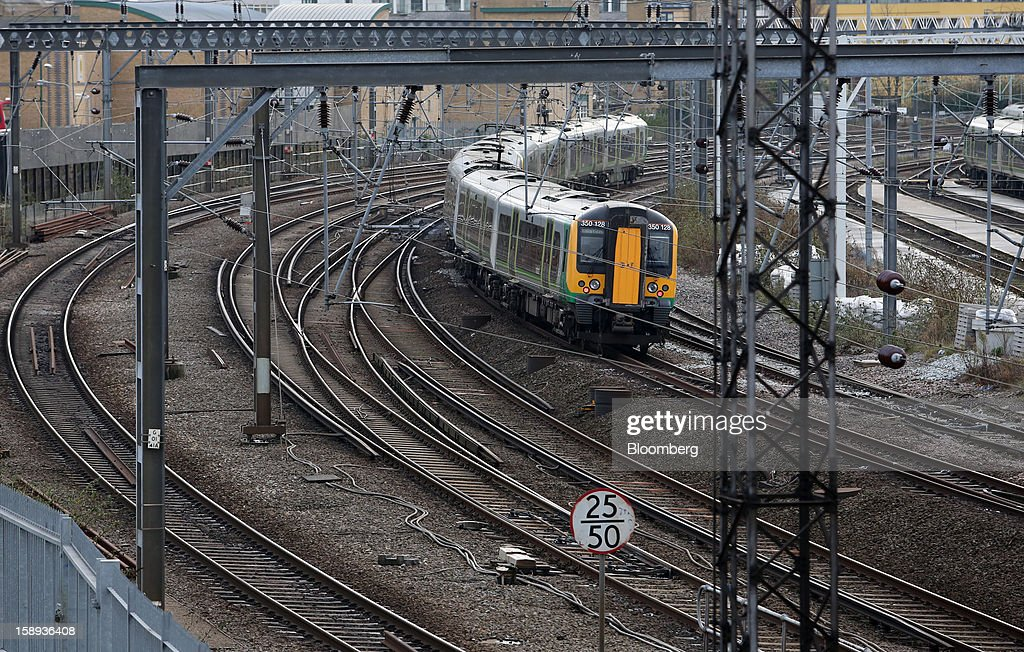 A London Midland train is seen arriving at Euston railway station in London, U.K., on Thursday, Jan. 3 2013. Rail commuters have been hit by inflation busting fare increases of up to 10 per cent, adding hundreds of pounds to the cost of annual season tickets. Photographer: Chris Ratcliffe/Bloomberg via Getty Images