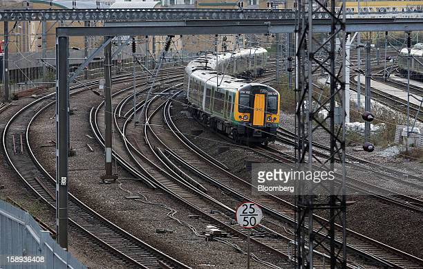A London Midland train is seen arriving at Euston railway station in London UK on Thursday Jan 3 2013 Rail commuters have been hit by inflation...
