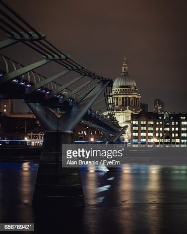London Millennium Footbridge Over Thames River Against St Paul Cathedral