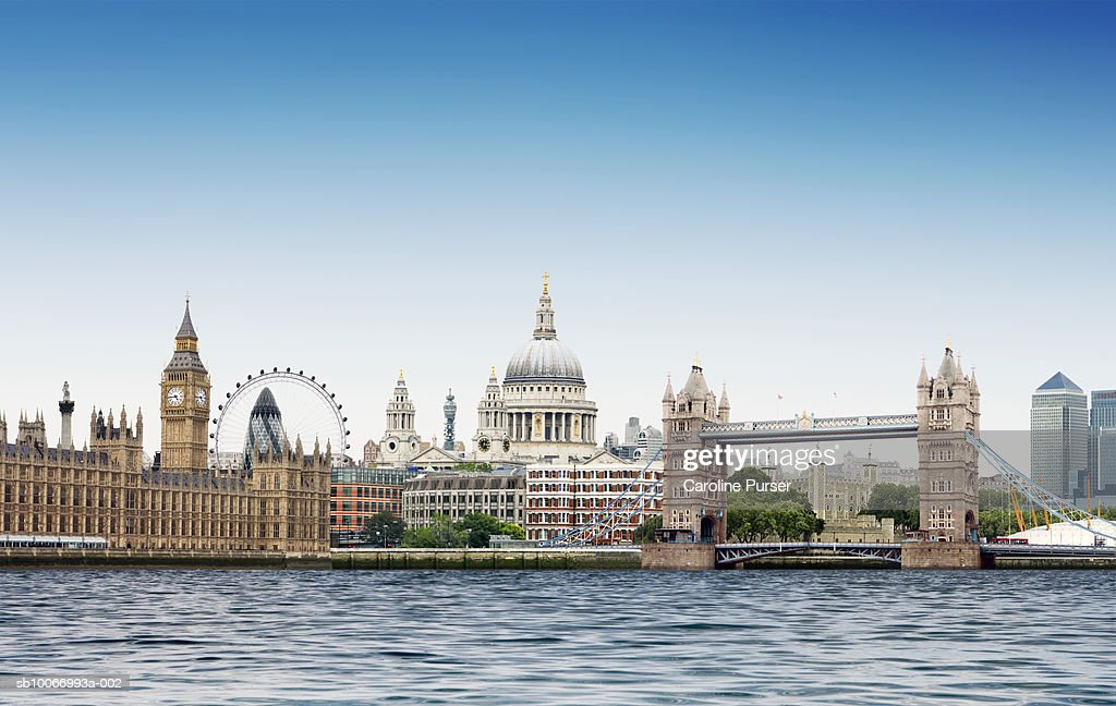 London montage against plain blue sky with River Thames in foreground : Stock Photo