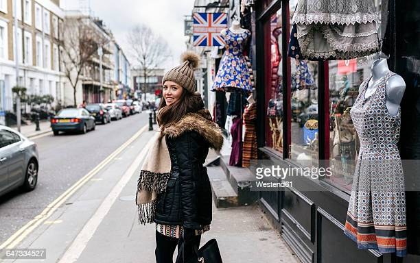 UK, London, Notting Hill, smiling young woman on shopping tour
