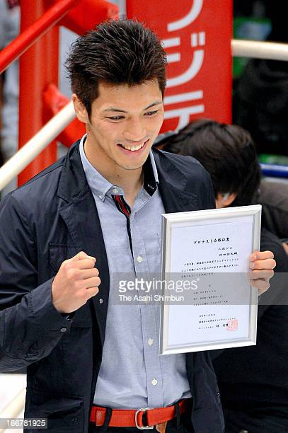 London Olympic Boxing Middleweight gold medalist Ryota Murata celebrates passing the test to be professional at Korakuen Hall on April 16 2013 in...