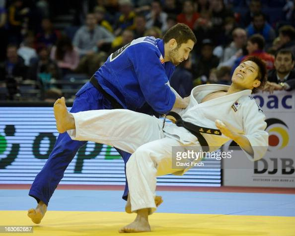 London Olympic champion JaeBum Kim of Korea is swept to the mat by Adrian Nacimento Lorenzo of Spain without conceding a score eventually winning the...
