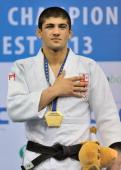 London Olympic champion Lasha Shavdatuashvili of Georgia listens to the Georgian anthem celebrating his u66kgs gold medal at the Budapest European...
