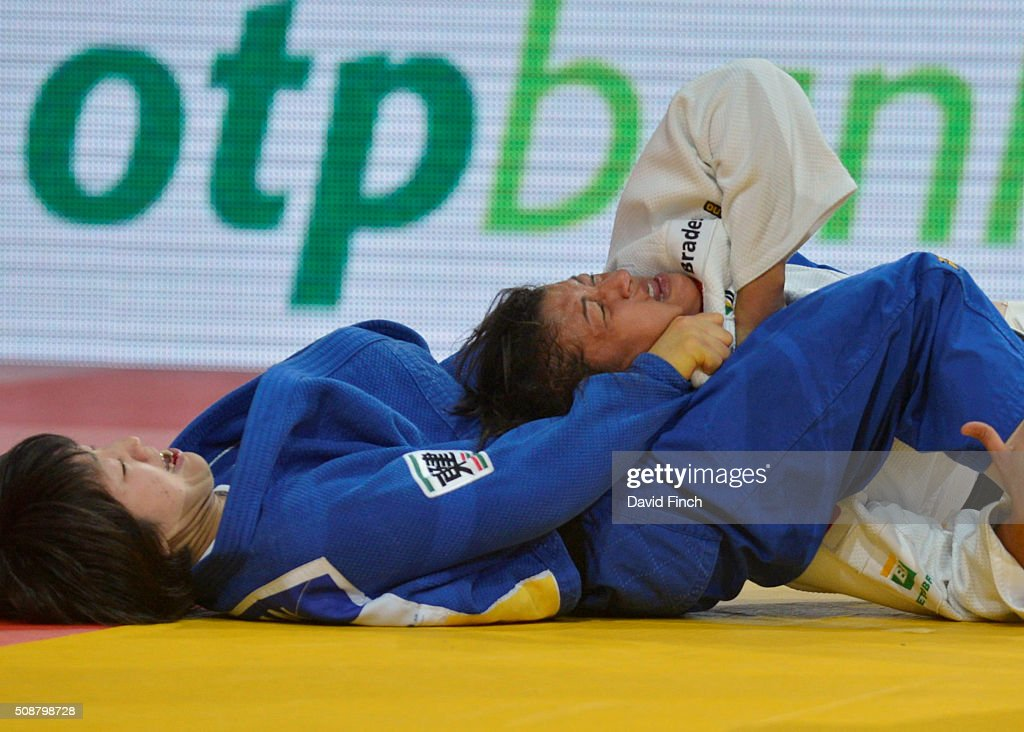 London Olympic champion Sarah Menezes of Brazil resists a strangle attempt by Haruna Asami of Japan to eventually win the contest and the u48kg...